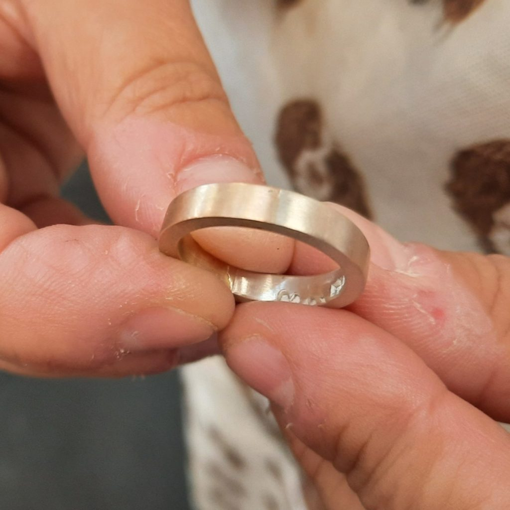 A mixed material ring using student's own repurposed gold and added silver