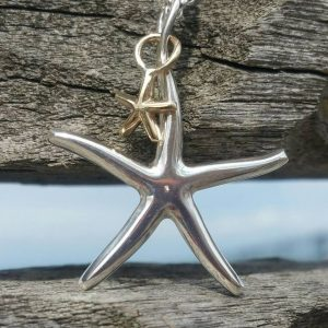 Starfish Pendant Necklace - with Solid Gold Baby by Rob Morris