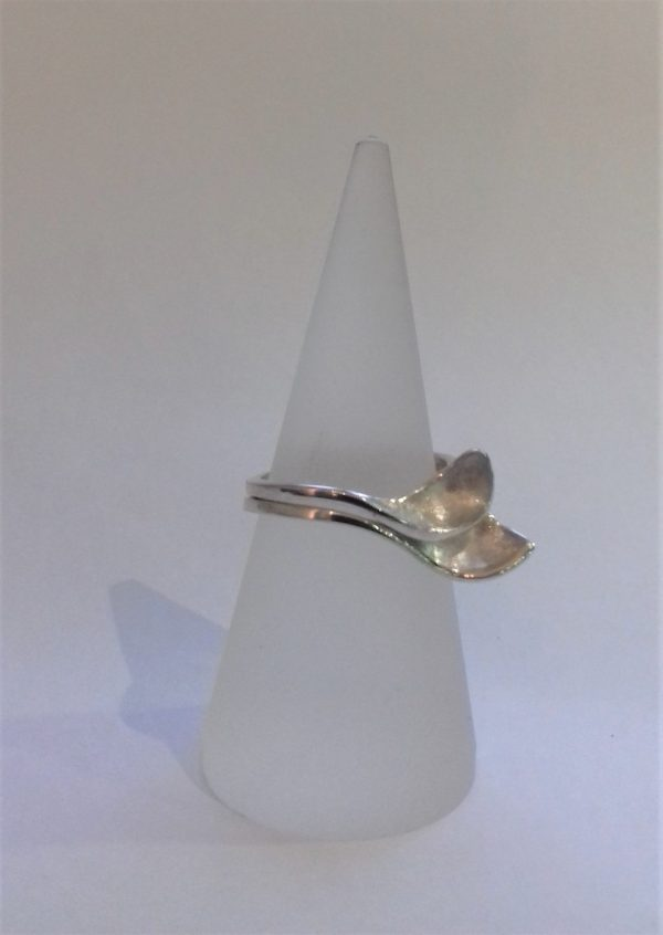 A pair of silver open and closed petal rings by Harriet Ferris
