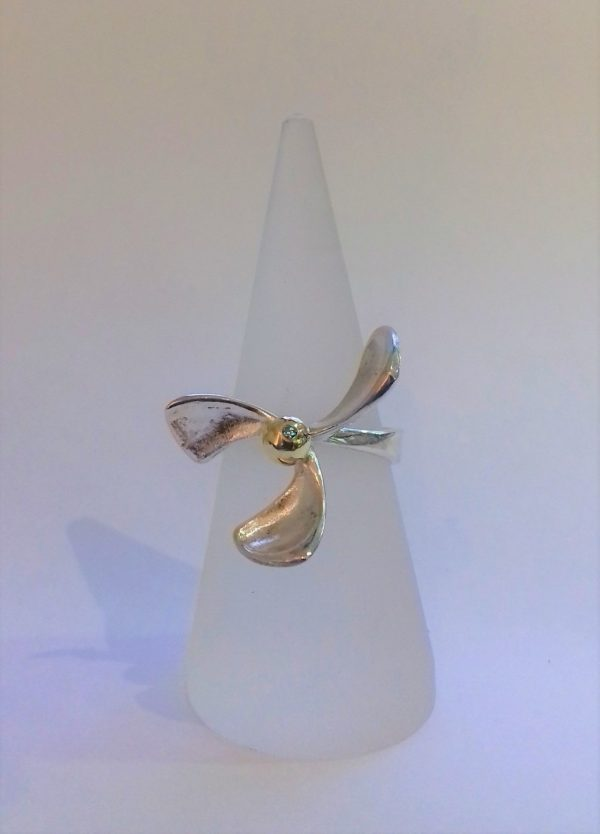 Silver triple petal ring with gold bead set with blue diamond by Harriet Ferris