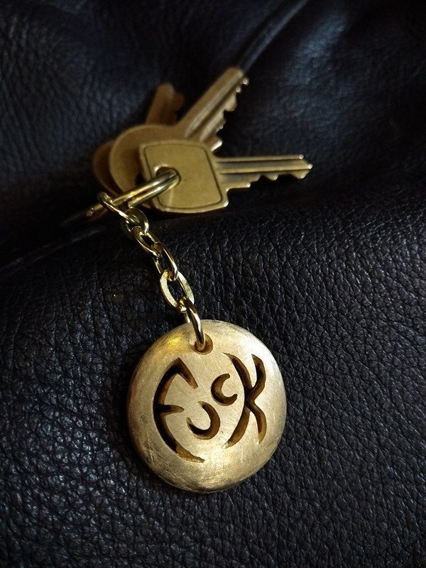 St. Christophuck Medallion Keyring by Rob Morris